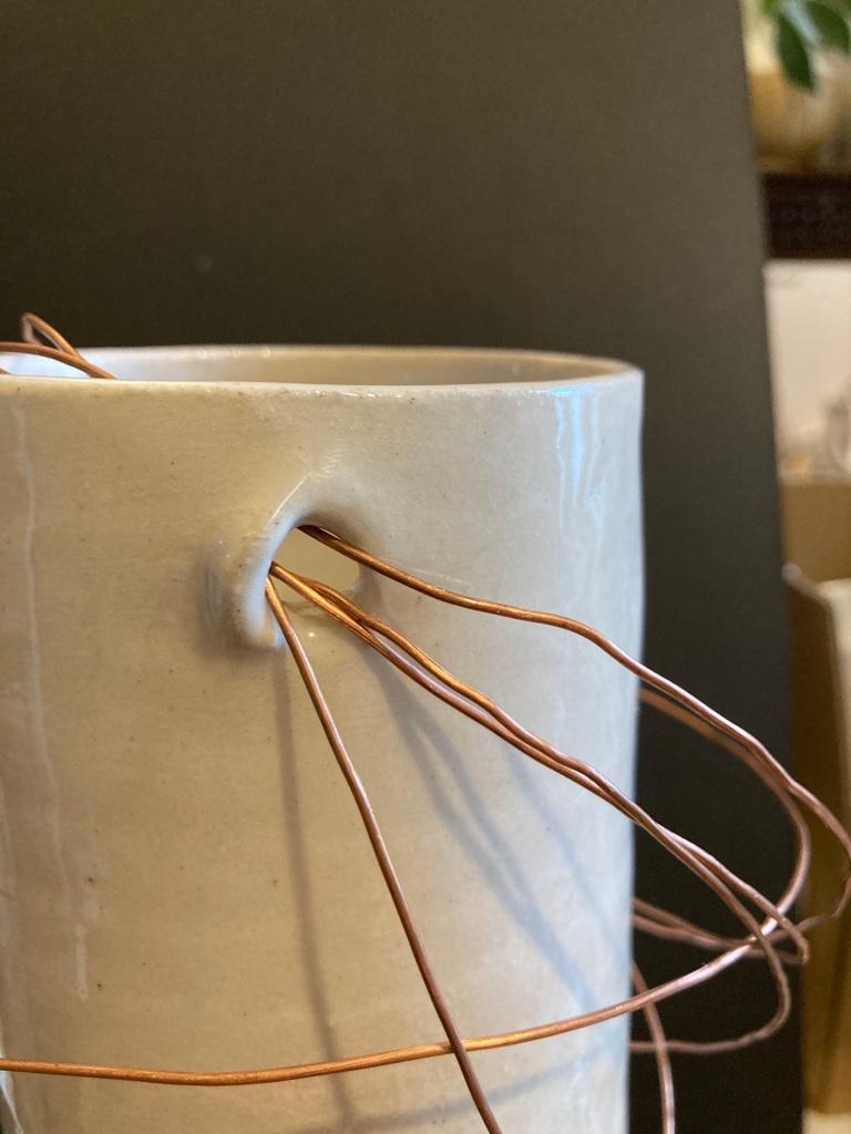 ceramic slipware pot with salvaged copper wire